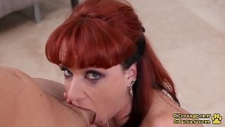 Busty redhead cougar drops to her knees to suck a cock in POV